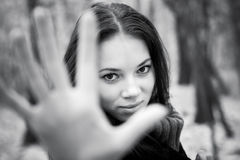 Woman stretching hand to the camera Royalty Free Stock Photo