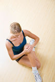 Woman stretching in health club Royalty Free Stock Photo