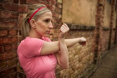 Woman stretching her arm Stock Photos