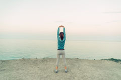 Woman stretching her arms outdoor Stock Photo