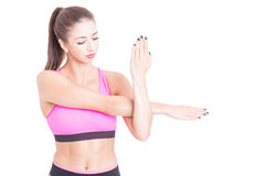 Woman stretching her arms preparing for exercises Royalty Free Stock Photos