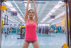 Woman stretching her arms in a sport bar Stock Photo