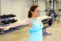 Woman stretching her arms to warm up Stock Photography