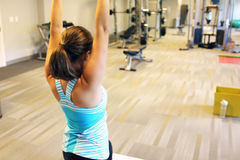 Woman stretching her arms to warm up Stock Photo