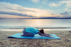 Woman stretching her back, yoga exercise Stock Photos
