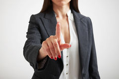 Woman stretching her finger Royalty Free Stock Photography