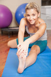 Woman stretching her foot Stock Photography