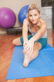 Woman stretching her foot Stock Images