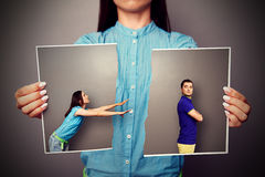 Woman stretching her hands to resentful man Stock Photos