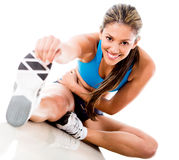 Woman stretching her leg Royalty Free Stock Images