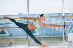 Woman stretching her leg at the barre stock photo