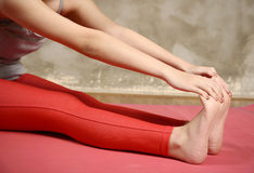 Woman Stretching Her Leg Royalty Free Stock Photography