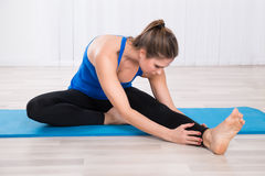 Woman Stretching Her Leg Stock Photo