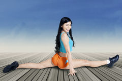 Woman stretching her legs Stock Image
