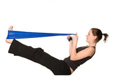 Woman is stretching her legs with a Resistance Ban royalty free stock photos