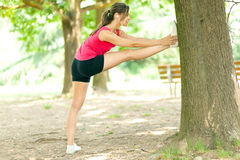Woman stretching her legs Stock Photography