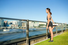 Woman stretching her legs before running Royalty Free Stock Photos