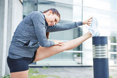Woman stretching her legs before running stock photo