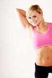 Woman stretching her muscles while exercising Stock Photography