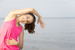 Woman stretching her sidebody outdoors Stock Photos