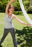 Woman stretching with her towel Royalty Free Stock Photography