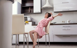 Woman stretching herself in morning on kitchen Royalty Free Stock Photo