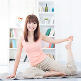 Woman stretching at home Stock Images