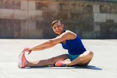 Woman stretching after, before jogging. Stock Photos