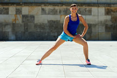 Woman stretching after, before jogging. Royalty Free Stock Image