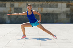 Woman stretching after, before jogging. Stock Image
