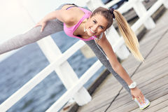Woman stretching before jogging Stock Photos