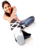 Woman stretching leg Stock Photo