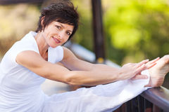Woman stretching leg Stock Image