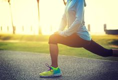 Free Woman Stretching Legs Before Run At Tropical Park Royalty Free Stock Photography - 105636757