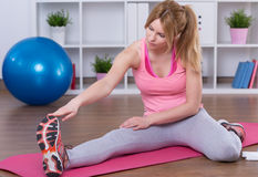 Woman stretching legs Royalty Free Stock Photo