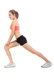 Woman stretching legs after jogging isolated Stock Photos