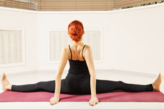 Woman stretching legs out arms behind Stock Photo