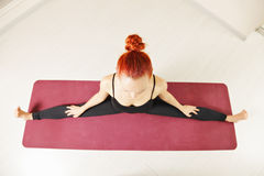 Woman stretching legs out Stock Photo