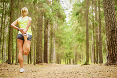 Woman stretching legs Stock Images
