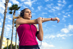 Woman stretching while listening to music Royalty Free Stock Images