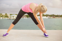 Woman stretching before morning exercise Stock Image