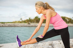 Woman stretching before morning exercise Stock Photo