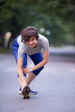 Woman  stretching before morning jogging Stock Photo