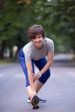 Woman  stretching before morning jogging Royalty Free Stock Photography
