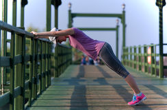 Woman  stretching before morning jogging Stock Images