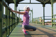 Woman  stretching before morning jogging Stock Photos