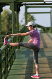 Woman  stretching before morning jogging Royalty Free Stock Image