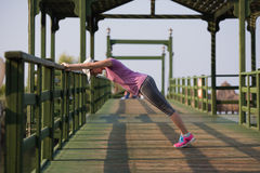 Woman  stretching before morning jogging Stock Image