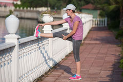 Woman  stretching before morning jogging Royalty Free Stock Images