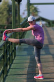 Woman  stretching before morning jogging Royalty Free Stock Photos